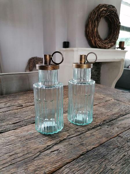 Afbeelding van Glazen fles met kandelaar dinerkaars